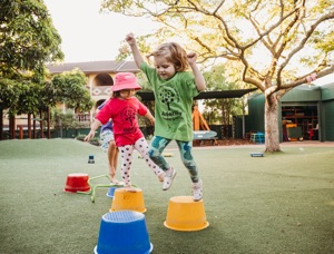 playing with buckets in kindy playground